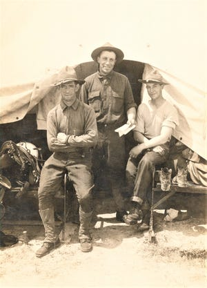 Private Lawrence Funk in the center with members of the Remount Squadron #302 in 1918.