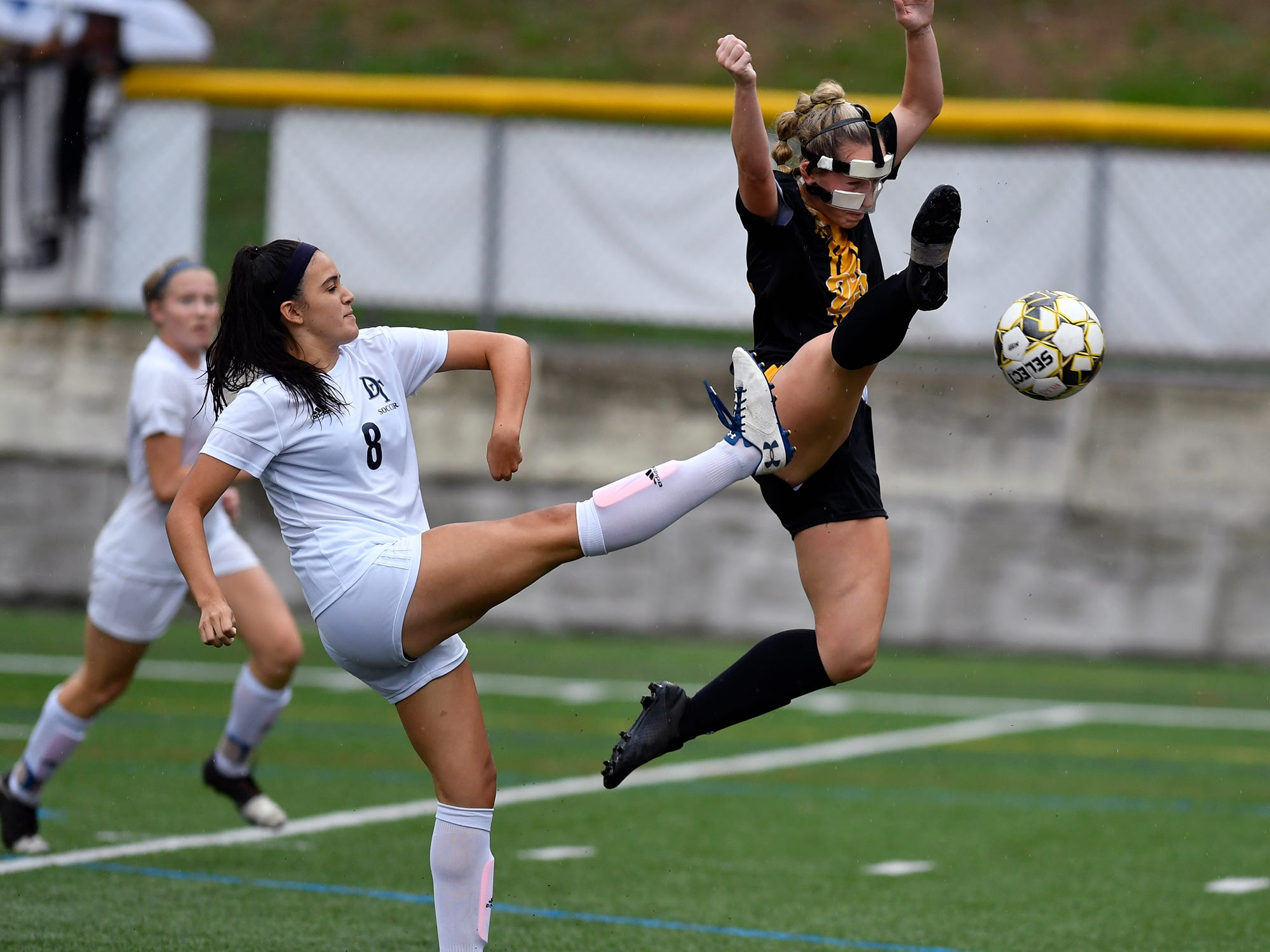 Red Lion's Gabby Young makes a leaping attempt to kick the ball away from Madelyn Rodriguez of Dallastown and into the goal, Thursday, Oct. 11, 2018. 