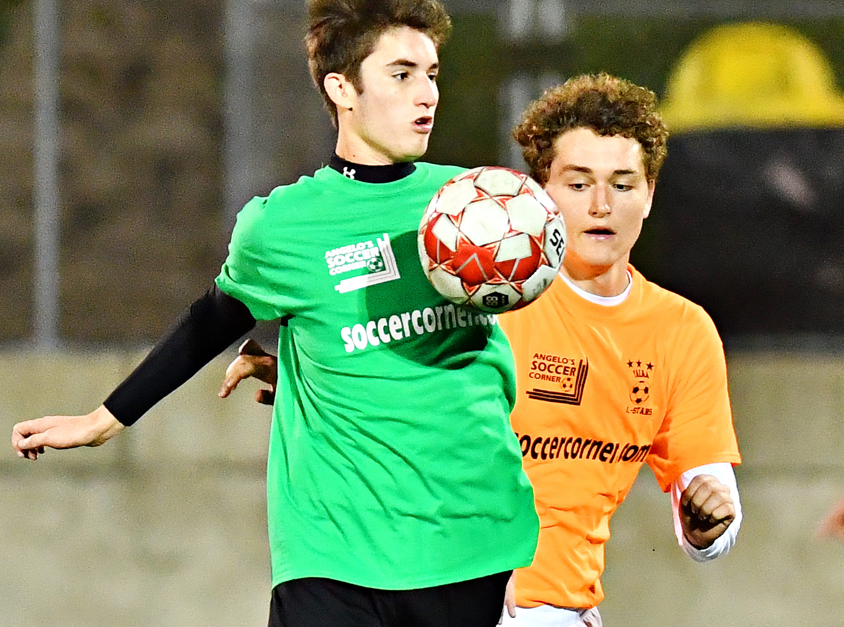 Central York's Michael Nelson, left, and West York's Aiden Clark compete for control of the ball during the YAIAA Boys' Soccer Senior All Star Game action at Horn Field in Red Lion, Wednesday, Nov. 7, 2018. Dawn J. Sagert photo