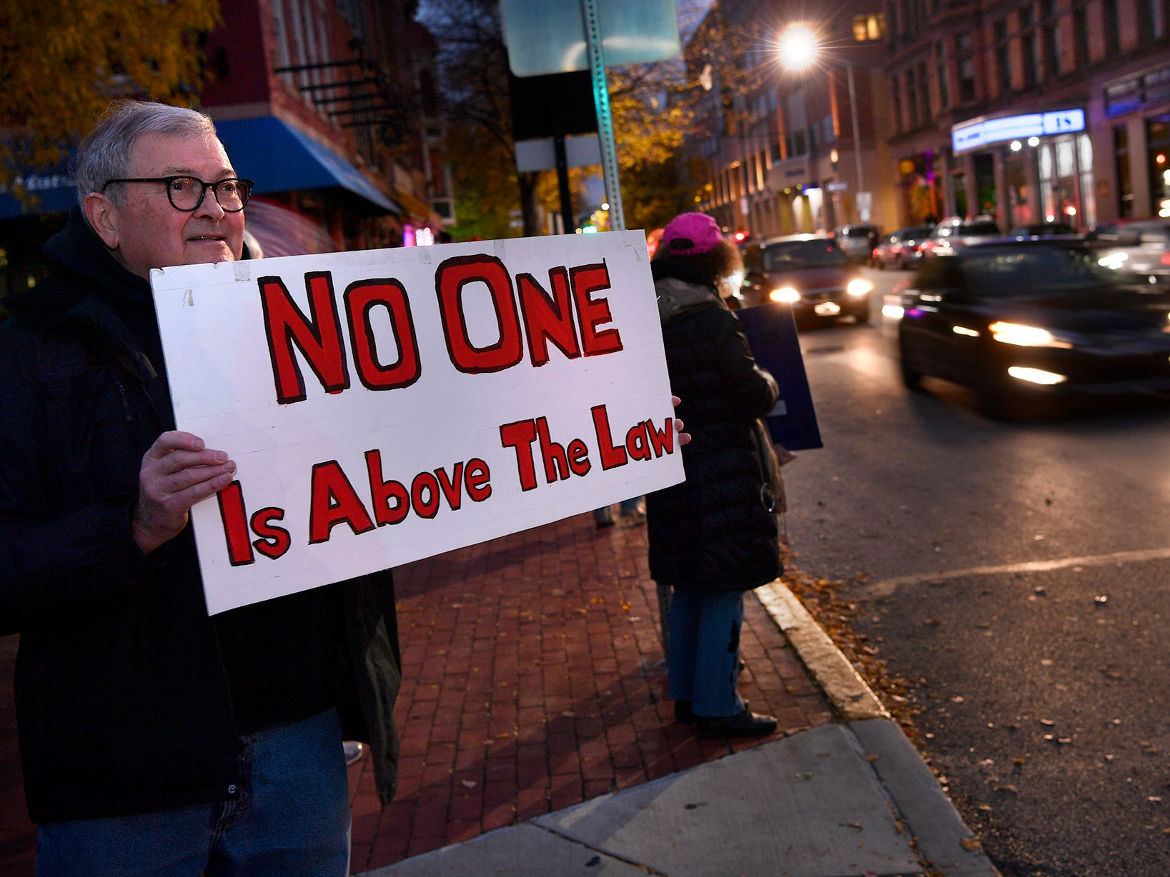 Dave Owens of York joins a  group of about 50 people inprotest on Continental Square in York following the forced resignation of Attorney General Jeff Sessions, Thursday, November 7, 2018. The event was sponsored by Indivisible York.