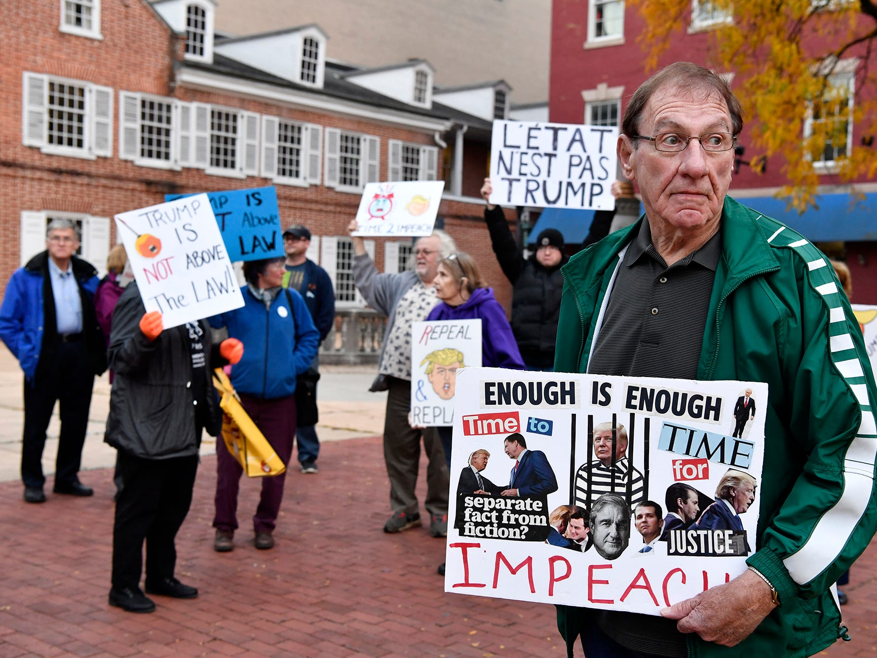 Donald Harbaugh of York New Salem, right, joins a group of about 50 people in protest on Continental Square in York following the forced resignation of Attorney General Jeff Sessions, Thursday, November 7, 2018. The event was sponsored by Indivisible York.