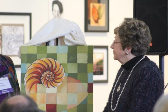 Women's Giving Circle chair Victoria Connor presents a painting to founder Carolyn Steinhauser as she was honored with a namesake award at a luncheon on Thursday, Nov. 8.  (Photo by Rebecca Klar)