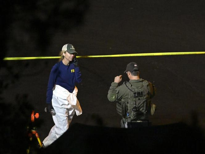"FBI agents work the scene Thursday, Nov. 8, 2018, in Thousand Oaks, Calif. where a gunman opened fire Wednesday inside a country dance bar crowded with hundreds of people on ""college night,"" wounding 11 people including a deputy who rushed to the scene. Ventura County sheriff's spokesman says gunman is dead inside the bar. (AP Photo/Mark J. Terrill)"