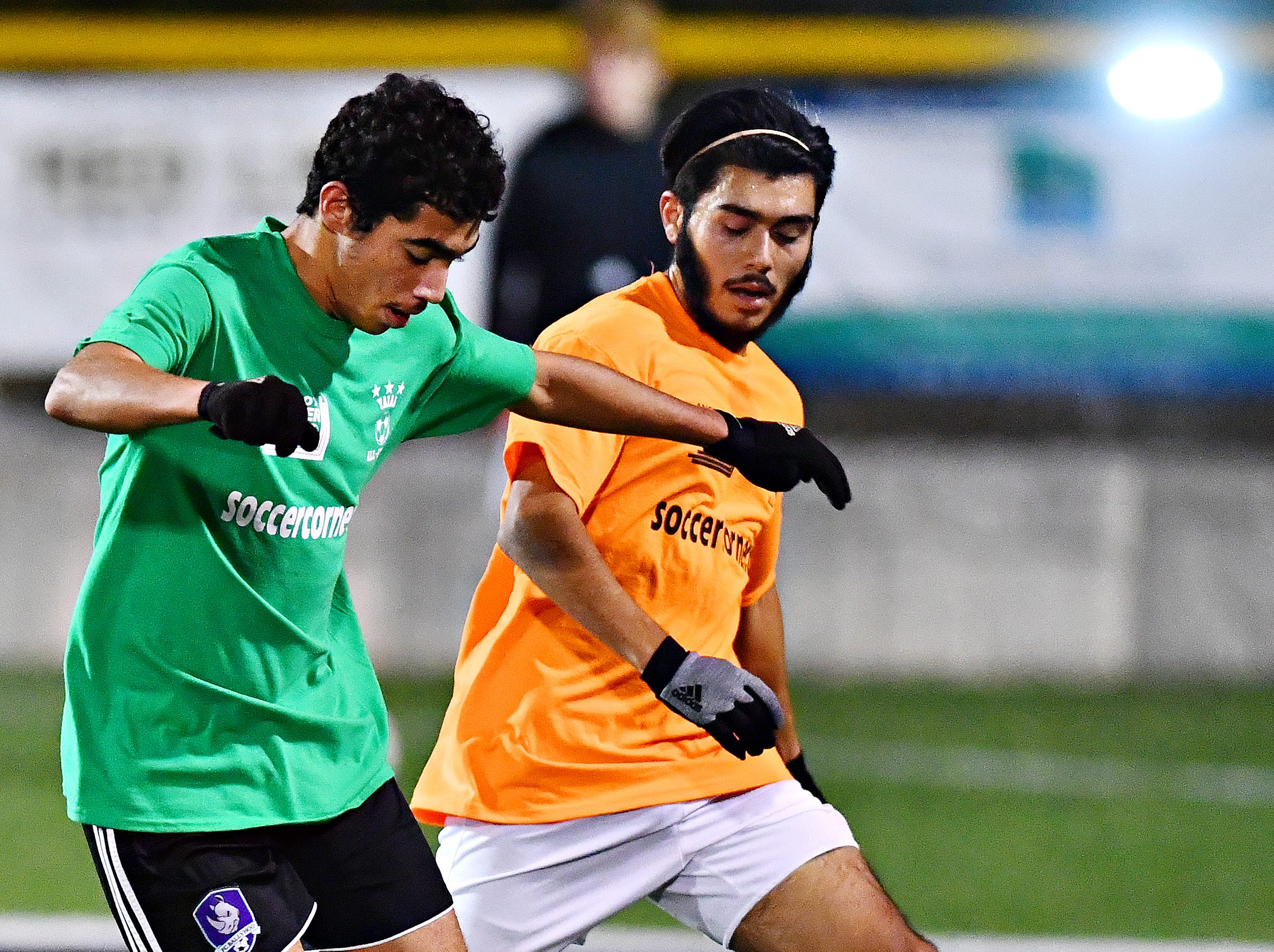 Dallastown's Leo Garcia, left, and Biglerville's Jorge Acevado battle for control of the ball during the YAIAA Boys' Soccer Senior All Star Game action at Horn Field in Red Lion, Wednesday, Nov. 7, 2018. Dawn J. Sagert photo
