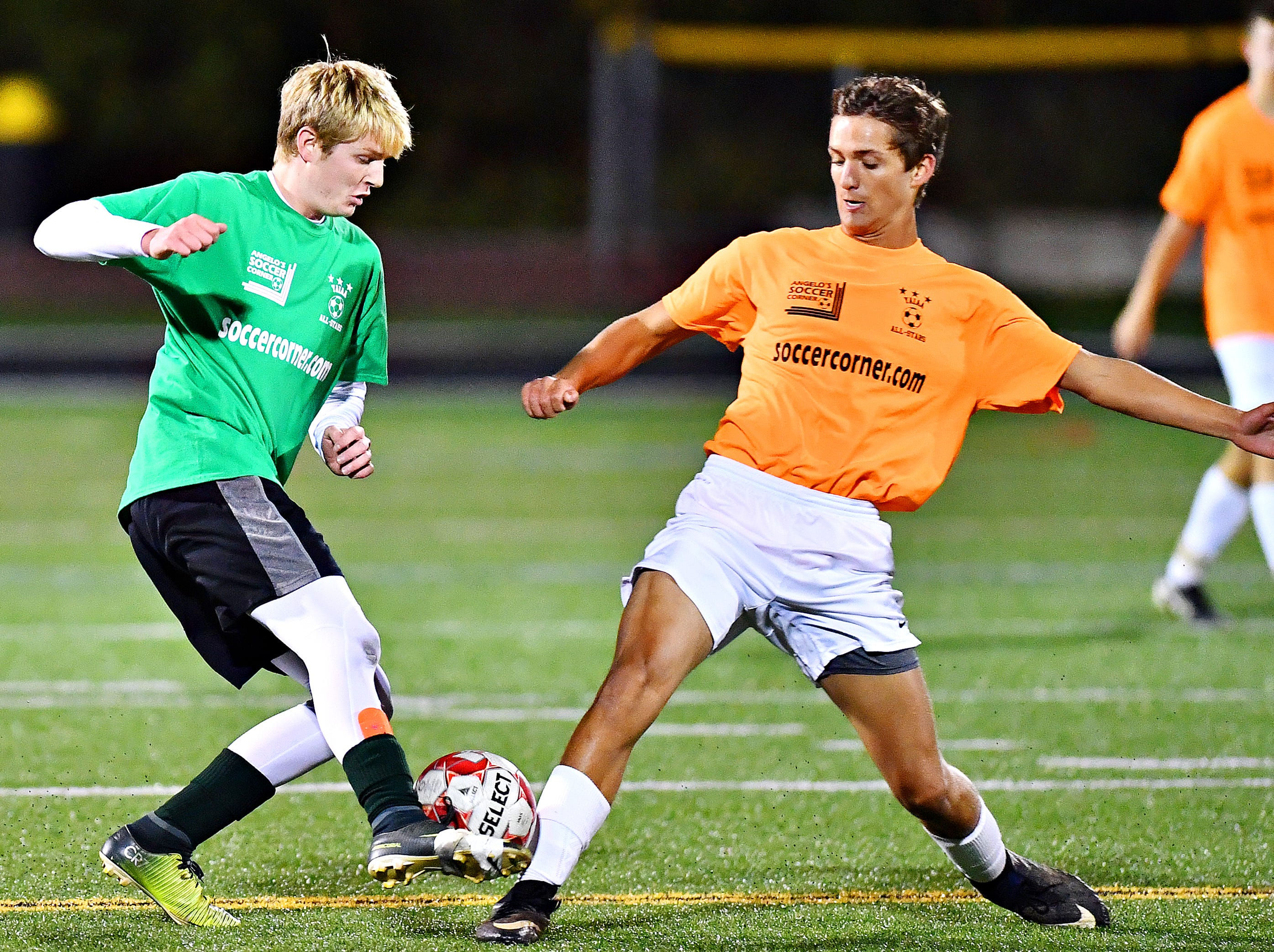 York Catholic's Bryan Bullen, left, and Bermudian Springs' Cole King battle for control of the ball during the YAIAA Boys' Soccer Senior All Star Game action at Horn Field in Red Lion, Wednesday, Nov. 7, 2018. Dawn J. Sagert photo