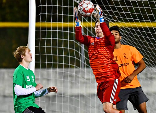 Kennard-Dale's Jake Ingoe stops the ball as athletes compete during the YAIAA Boys' Soccer Senior All Star Game action at Horn Field in Red Lion, Wednesday, Nov. 7, 2018. Dawn J. Sagert photo