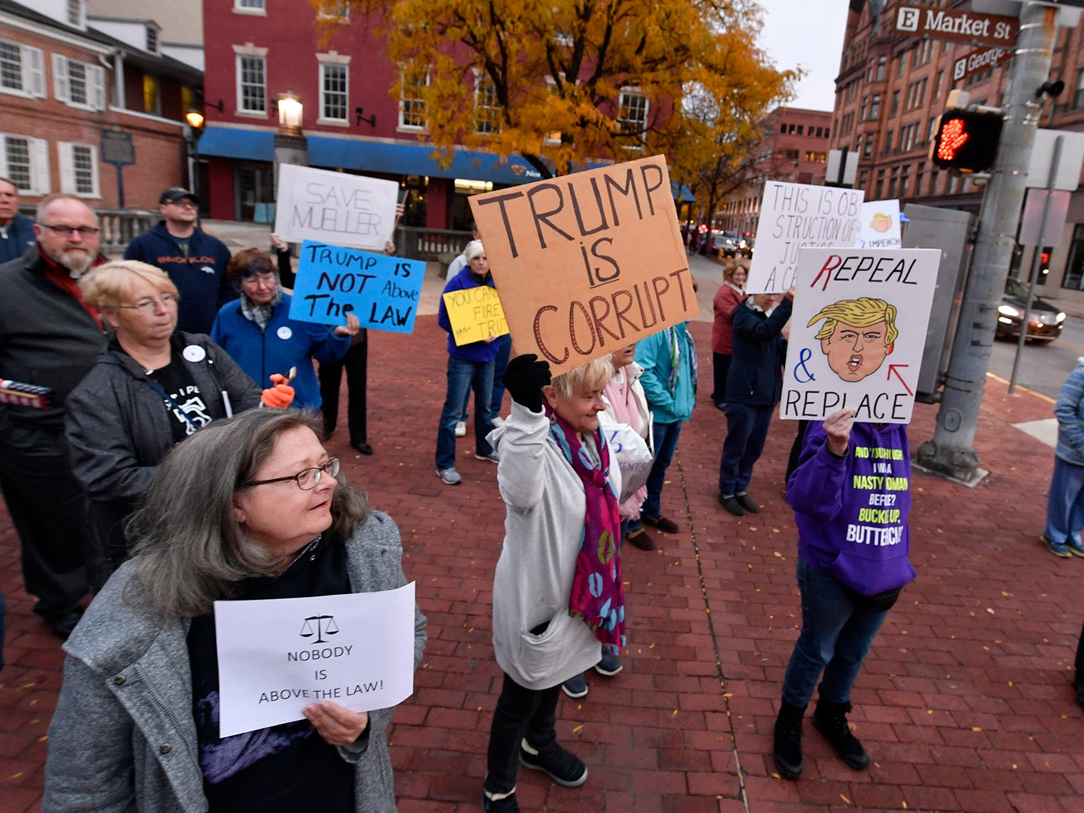 A group of about 50 people protest on Continental Square in York following the forced resignation of Attorney General Jeff Sessions, Thursday, November 7, 2018. The event was sponsored by Indivisible York.