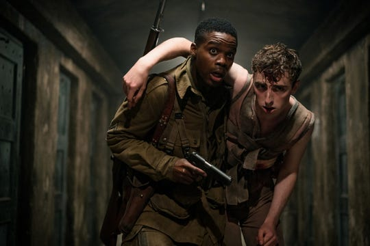 "From left, Jovan Adepo stars as Boyce and Dominic Applewhite as Rosenfeld in the film, ""Overlord."" The movie is playing at Regal West Manchester Stadium 13 and R/C Hanover Movies."