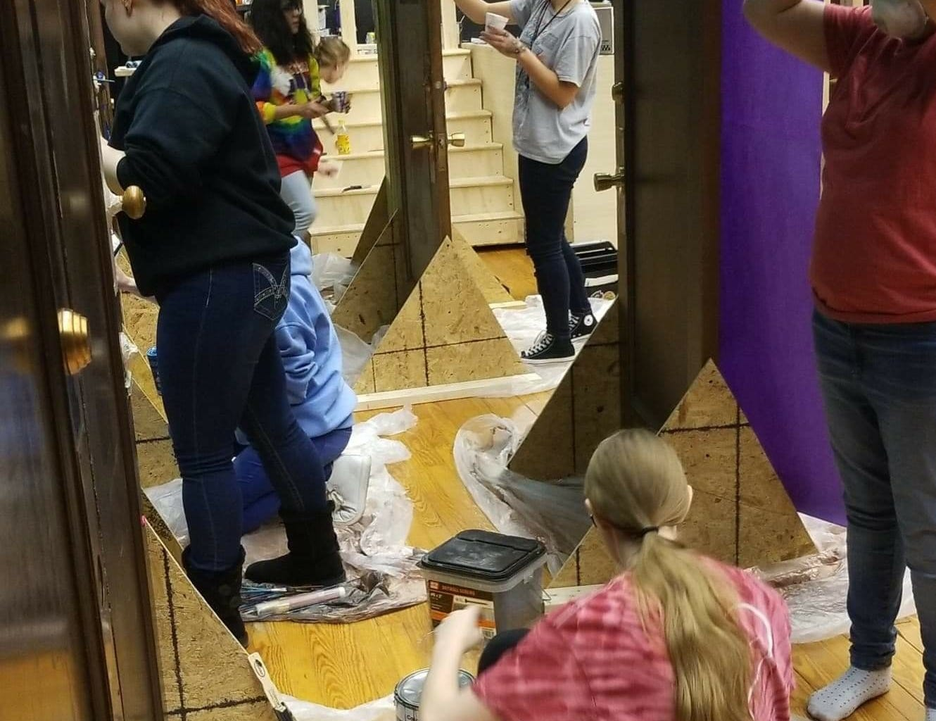 "York County School of Technology students working on the doors for their upcoming production of ""Alice in Wonderland,"" which is a collaboration with Weary Arts Group."