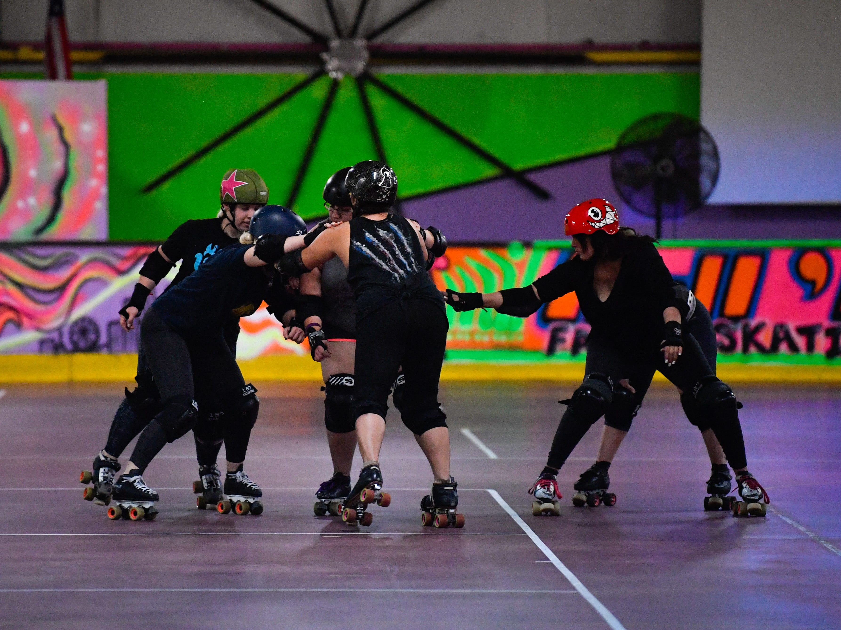The Derby Dames go over formations and strategies in practice, Thursday, October 18, 2018.