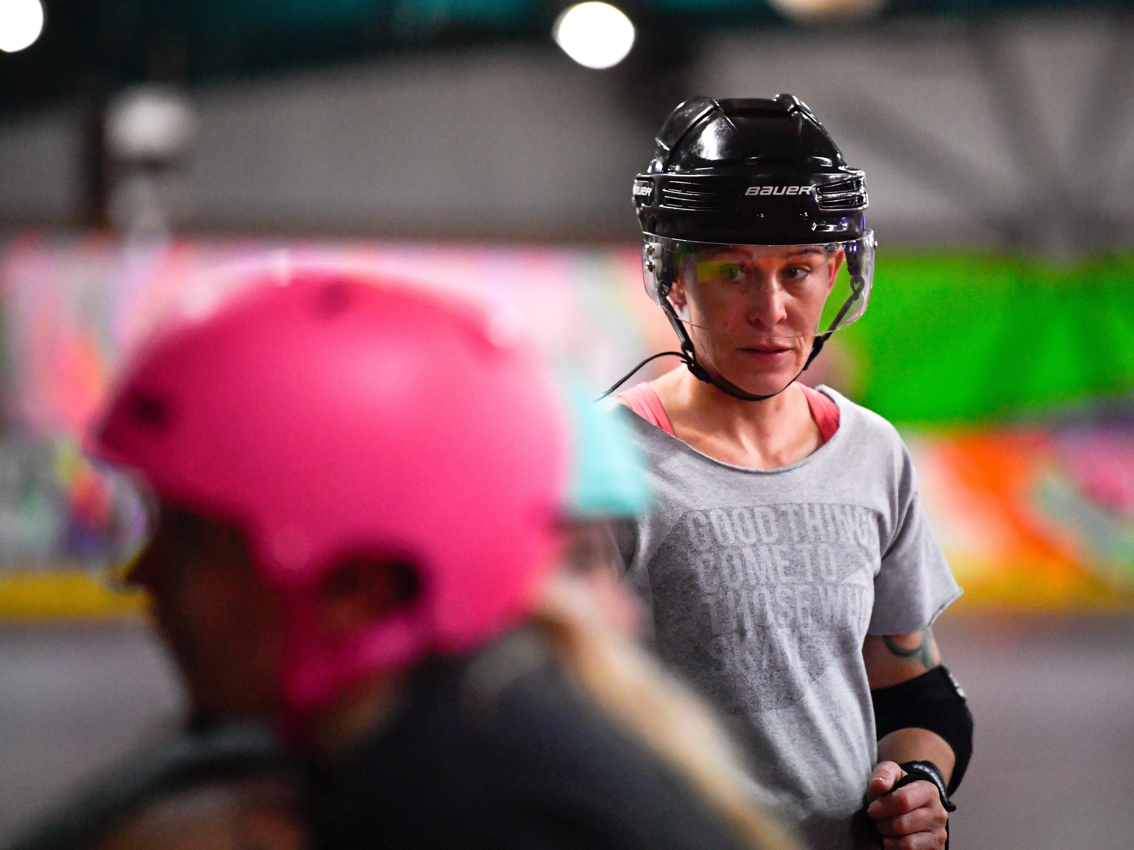 York City Derby Dames player-coach Jamie Moore observes two teammates during practice, Thursday, October 18, 2018.