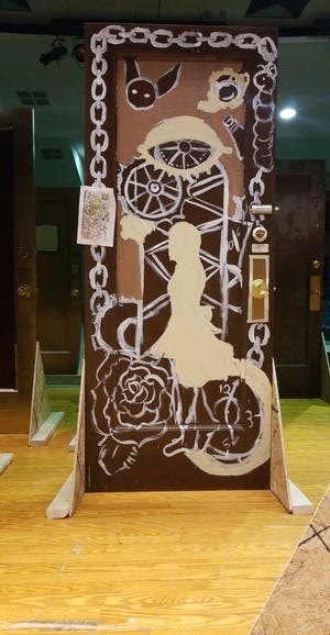 """This is one of the doors salvaged from the Yorktowne Hotel during ongoing renovations. It was designed by students for use in the York County School of Technology's  recent production of """"Alice in Wonderland."""""""