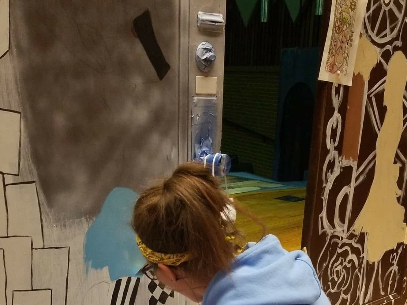 "A York County School of Technology student working on a salvaged Yorktowne Hotel door for the upcoming production of ""Alice in Wonderland,"" which is a collaboration with Weary Arts Group."