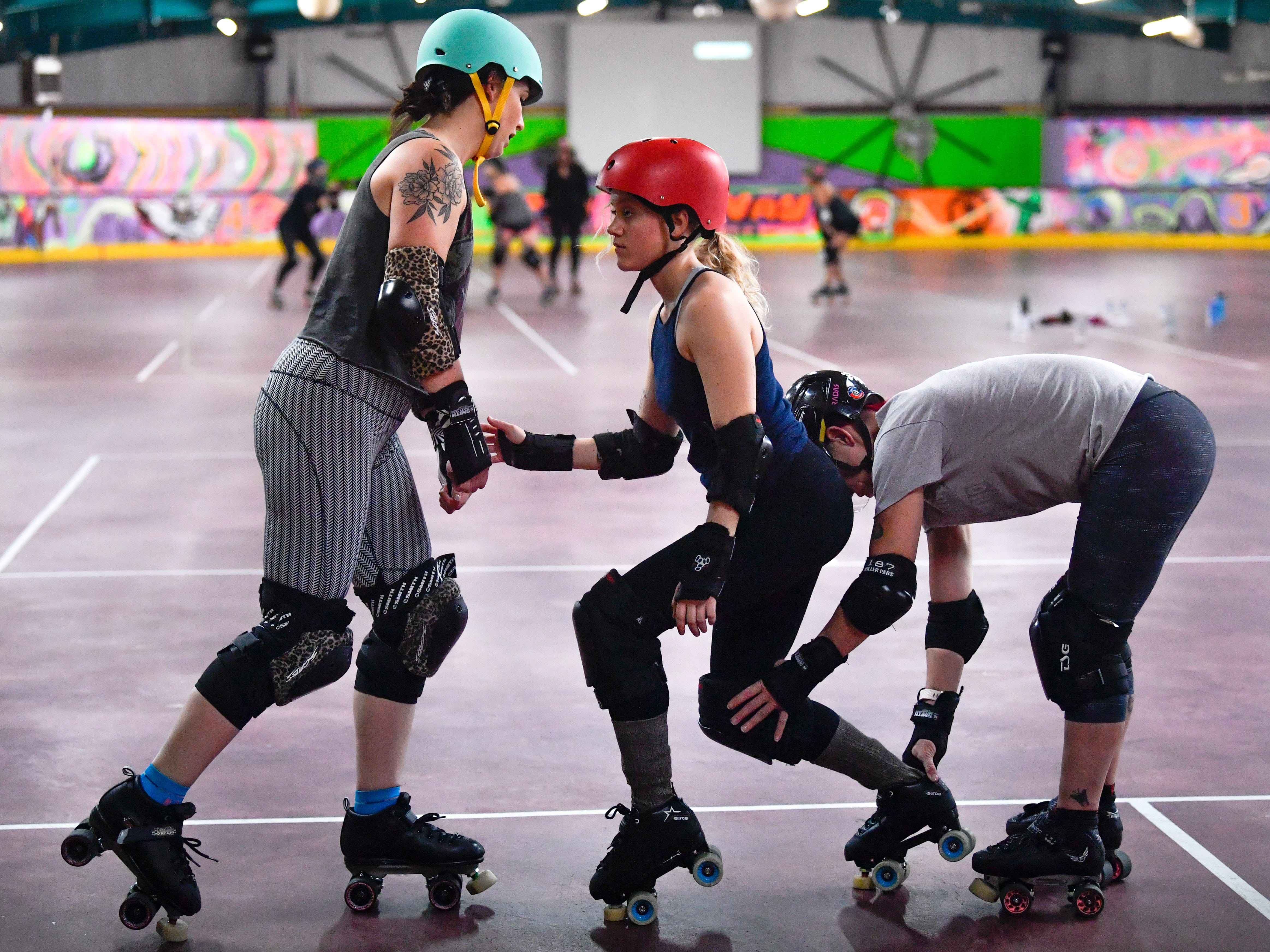 Derby Dames players work on their foot work during  practice at Roll 'R' Way, Thursday, October 18, 2018.