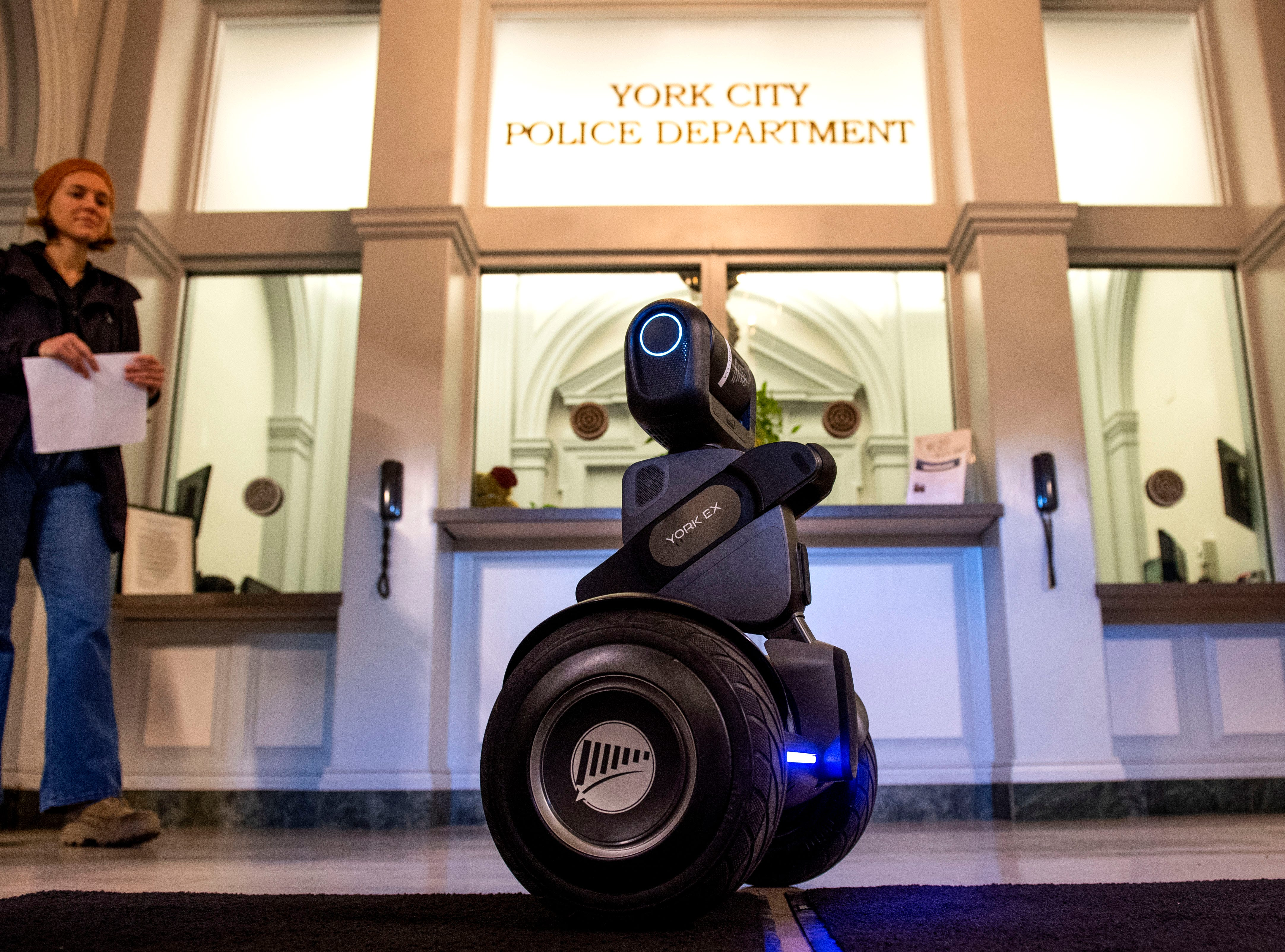 The 'Loomo,' seen here in the York City Police Department, is a two-wheeled robot that York Exponential believes could help city police in the future. Company CEO John McElligott gave a demonstration to Officer Derek Hartman and others on Thursday.