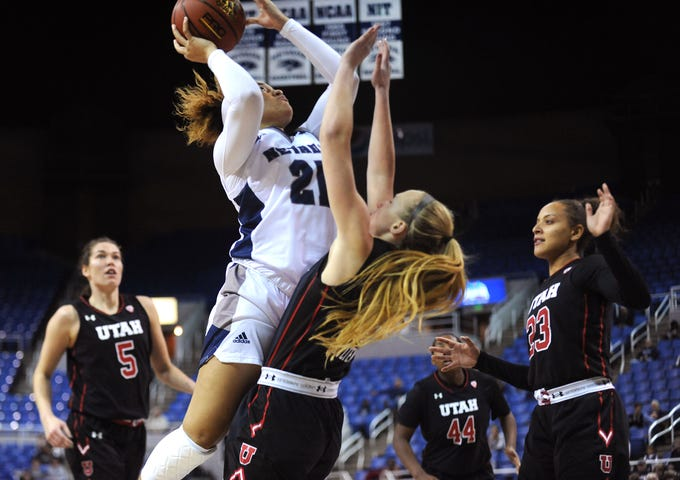 Nevada's Imani Lacy (21) scores while taking on Utah during their basketball game at Lawlor Events Center in Reno on Nov. 7, 2018.