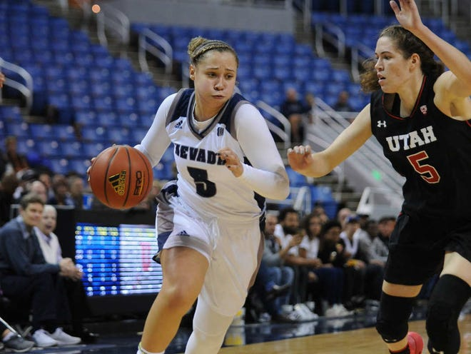 Nevada's Mikayla Christian, left, drives against Utah's Megan Huff on Wednesday night.