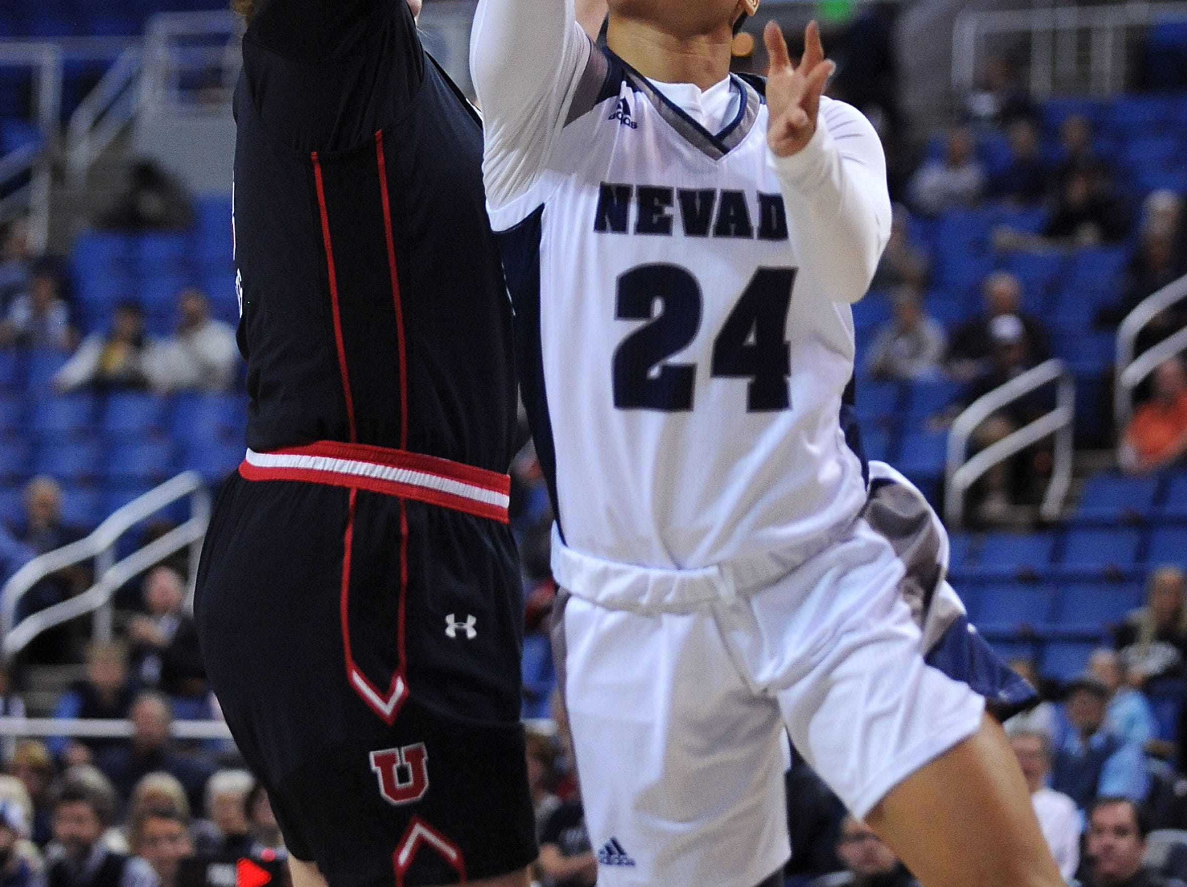 Nevada's Camariah King (24) shoots while taking on Utah during their basketball game at Lawlor Events Center in Reno on Nov. 7, 2018.