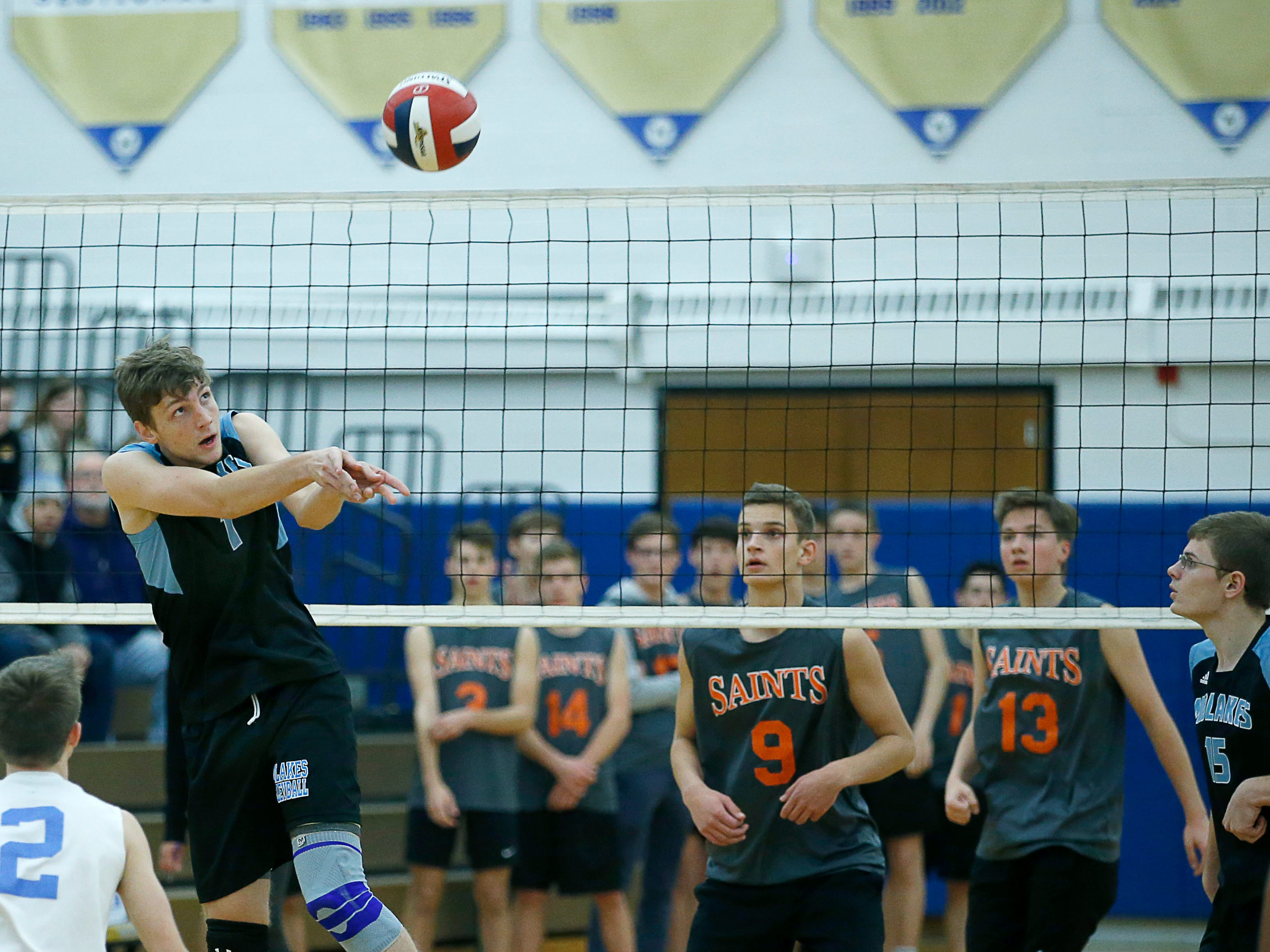 Class B volleyball final: Midlakes' Ben Jansen sets up against Churchville-Chili in the first set at Webster Schroeder High School.