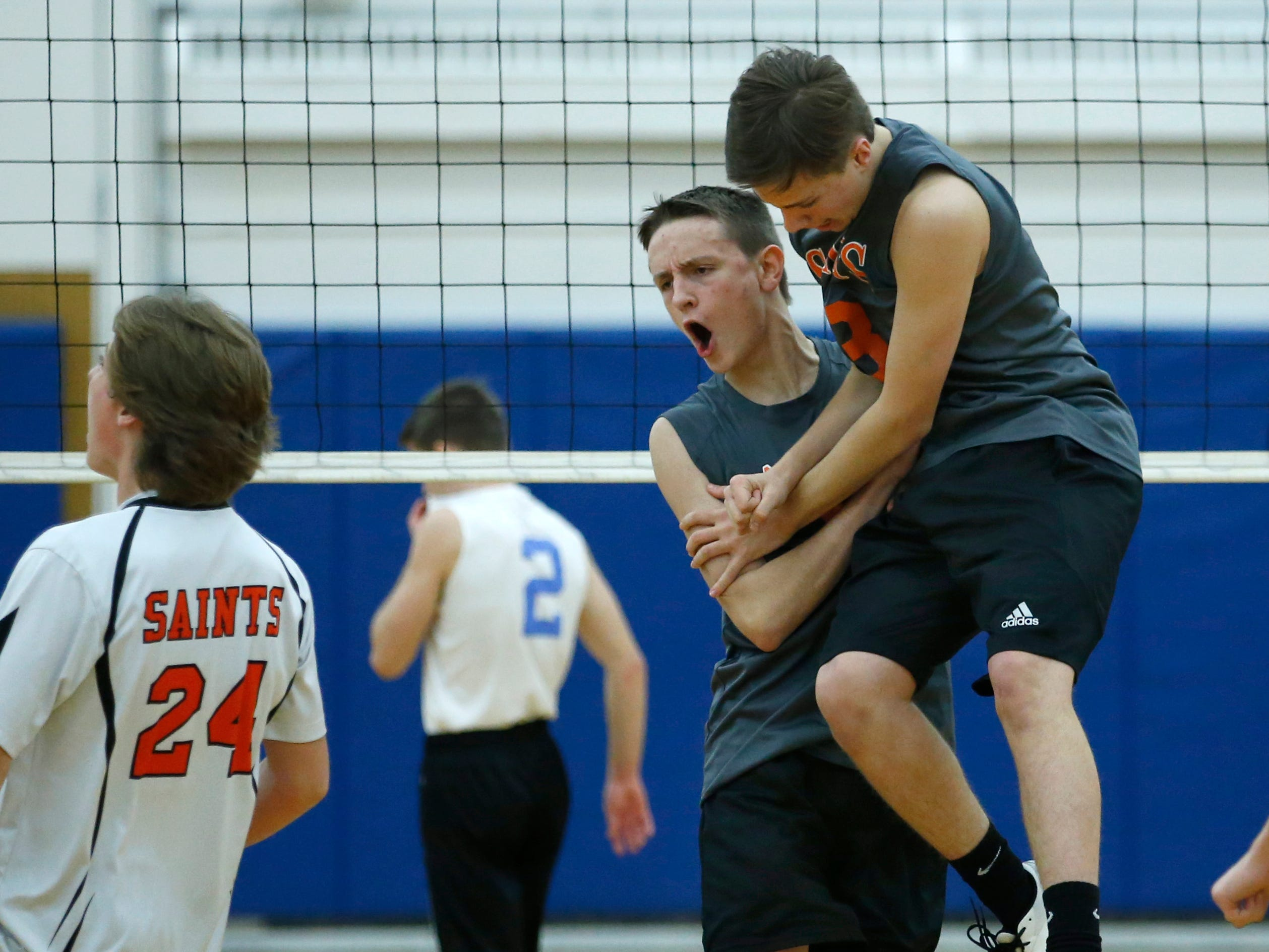 Class B volleyball final: Churchville-Chili's Griffin Stella and Joe Wollke celebrate an 8-3 lead against Midlakes in the first set at Webster Schroeder High School.
