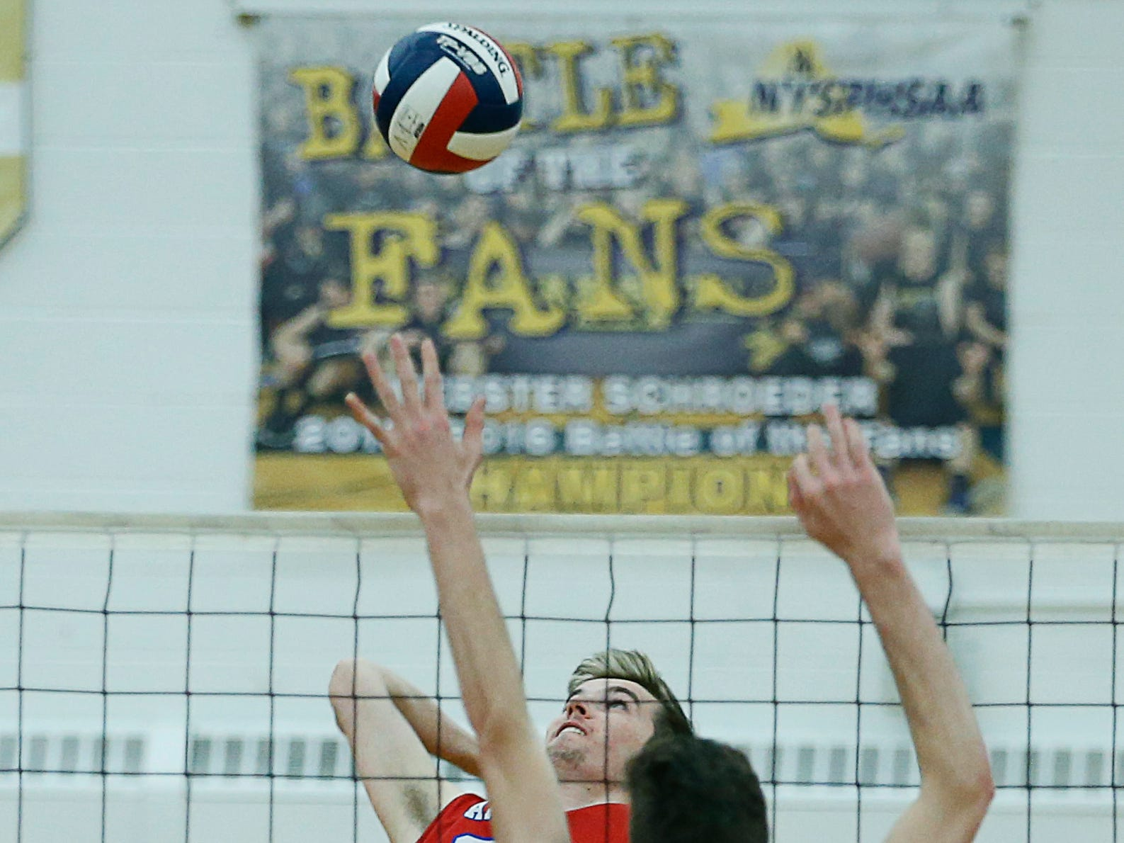 Class A volleyball final: Fairport's Ryan Parker attacks against McQuaid in the first set at Webster Schroeder High School.