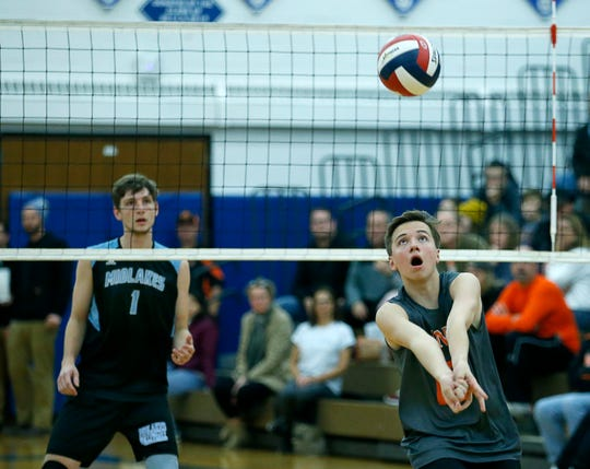 Class B volleyball final: Churchville-Chili's Joe Wollke saves and sets up against Midlakes in the second set at Webster Schroeder High School.