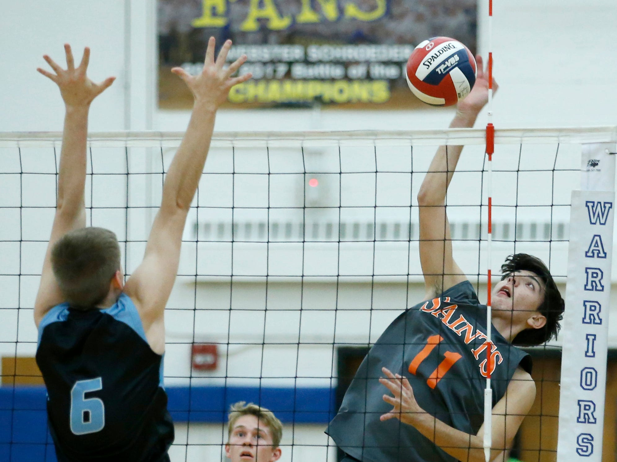 Class B volleyball final: Churchville-Chili's Matteo Ventura attacks against Midlakes' Maverick Coryell in the first set at Webster Schroeder High School.