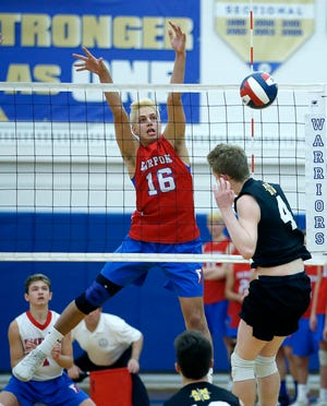 Class A volleyball final: Fairport's Graham Brodsky blocks an attack by McQuaid's Owen Wickens in the first set at Webster Schroeder High School.