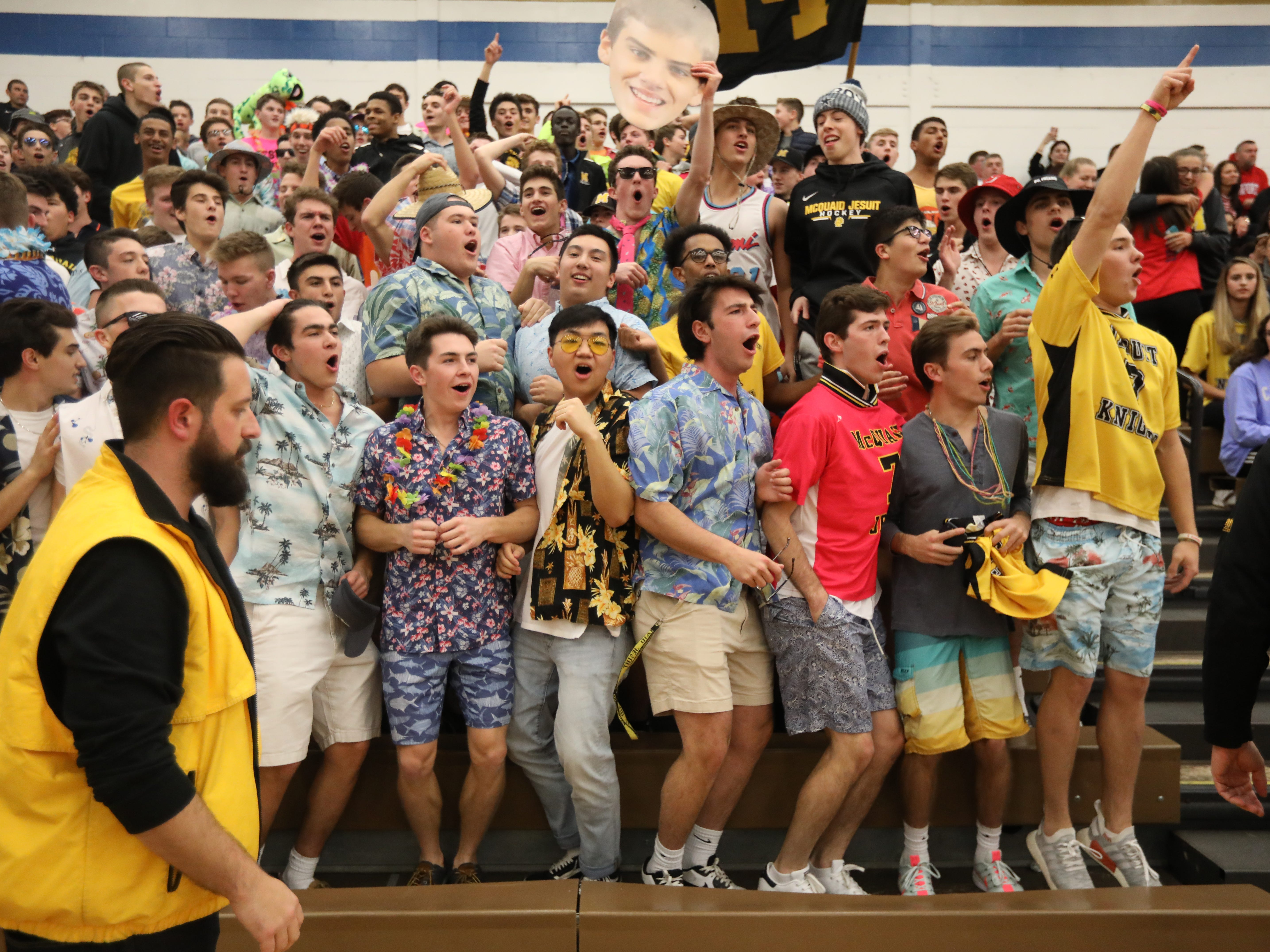 Class A volleyball final: McQuaid fans cheer during the game against Fairport at Webster Schroeder High School.