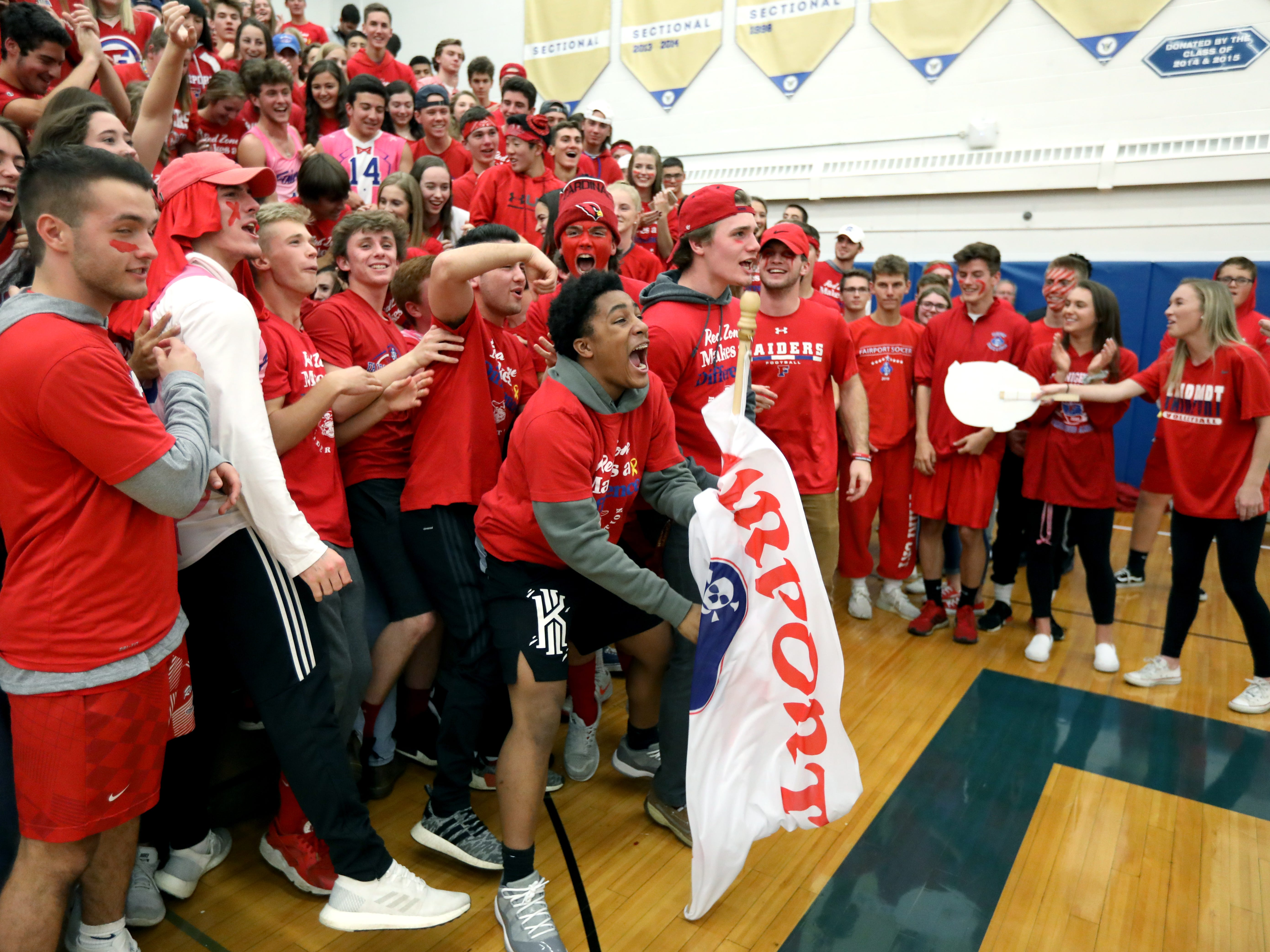 Class A volleyball final: Fairport fans cheer as they lead McQuaid in the first set at Webster Schroeder High School.