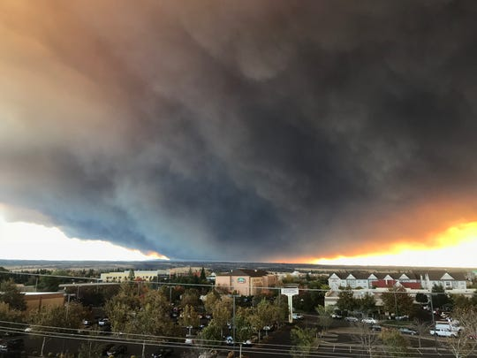 The massive plume from the Camp Fire, burning in the Feather River Canyon and near Paradise, wafts over the Sacramento Valley as seen from Chico on Thursday morning. (David Little -- Enterprise-Record)