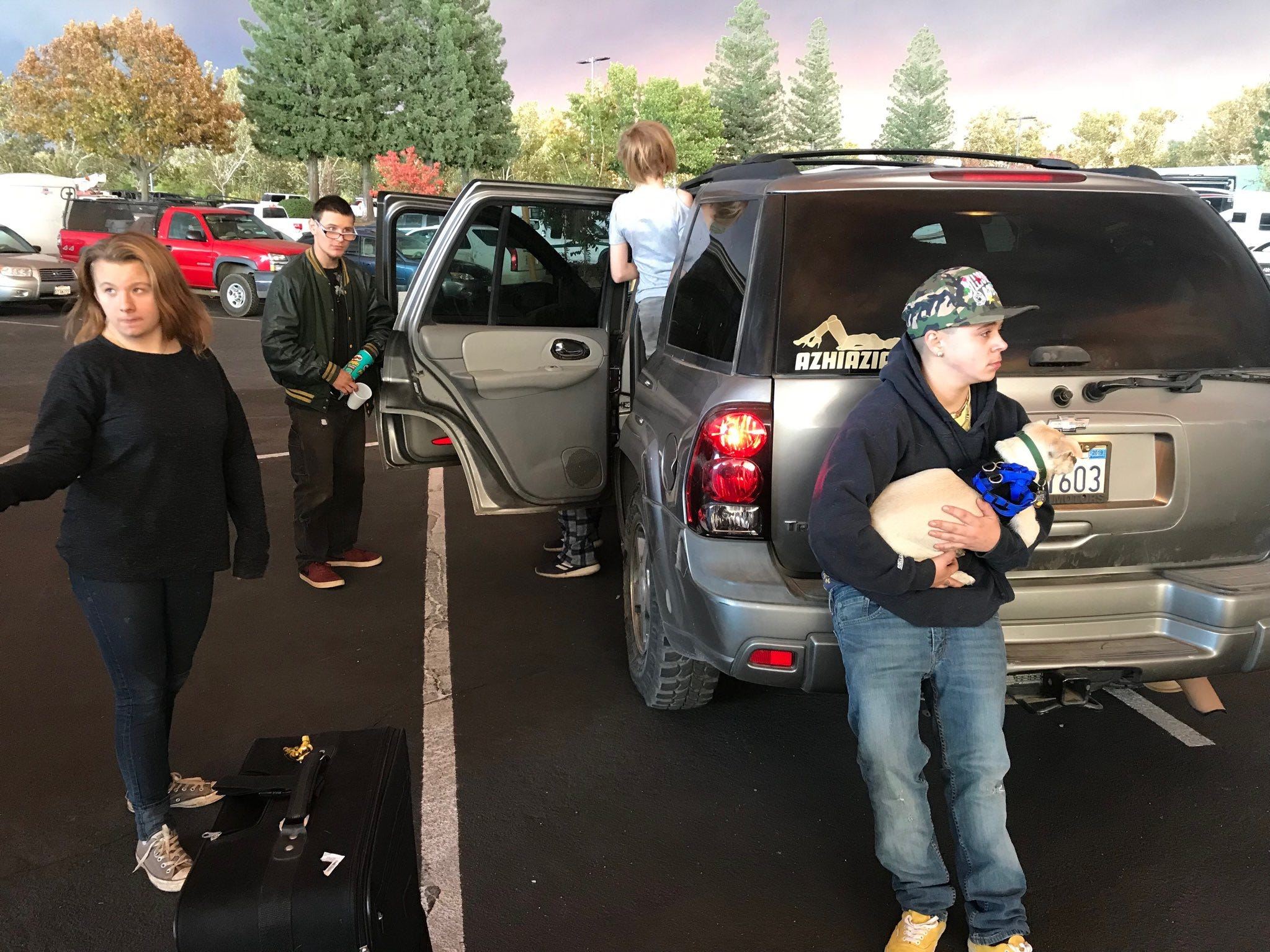 Some families evacuated out of Paradise gathered Thursday, Nov. 8, 2018 in the parking lot at the Chico Mall.