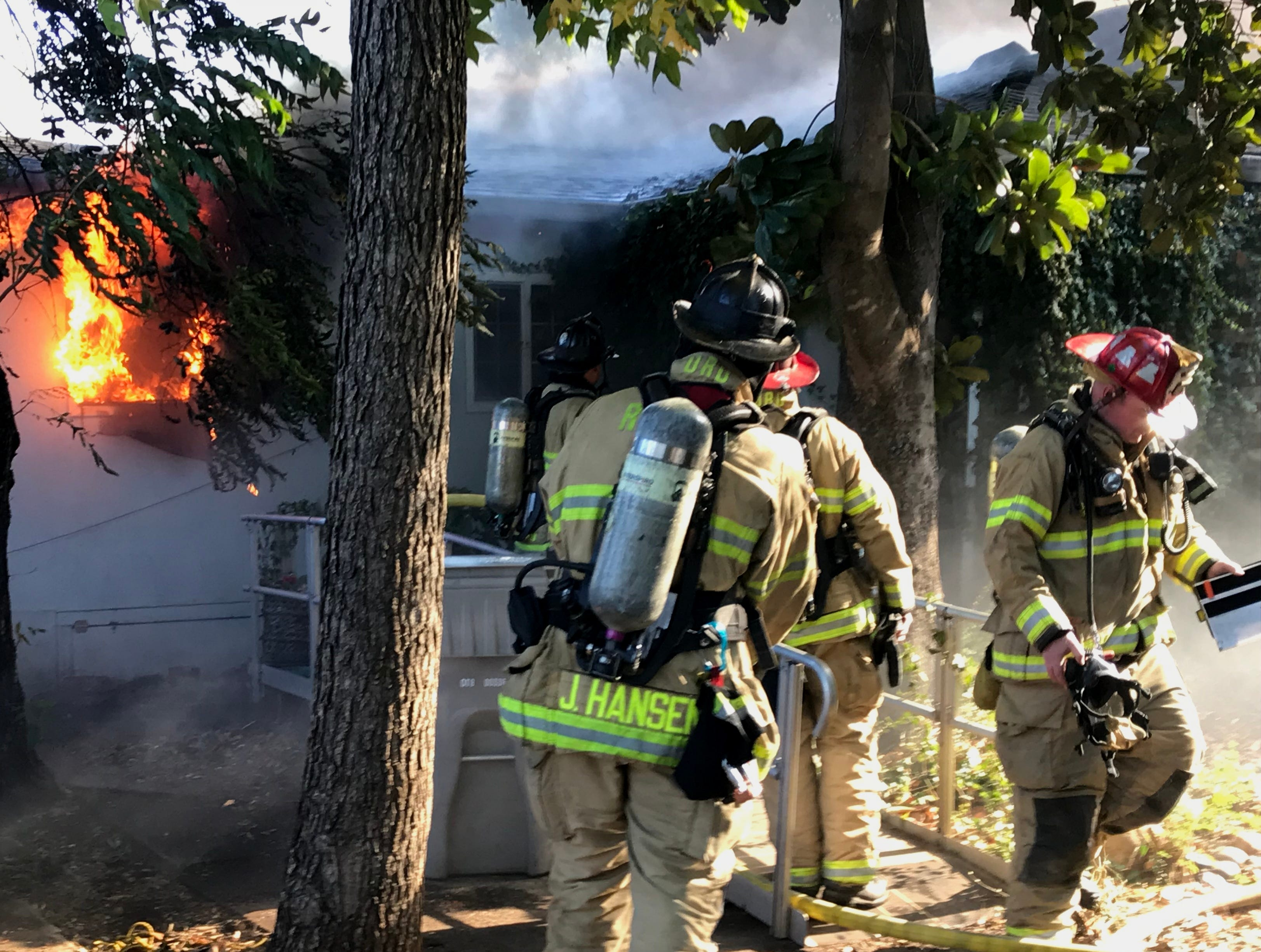 Redding firefighters fight two house fires Thursday on Blueview Street.