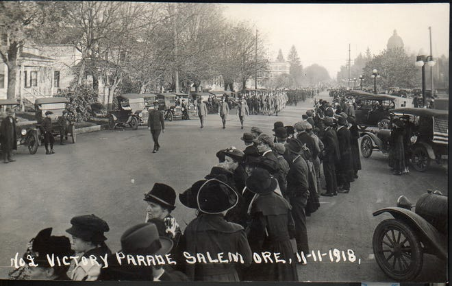 A parade on Nov. 11, 1918, celebrates the end of World War I. The view is looking east on Court Street NE near High Street in Salem.