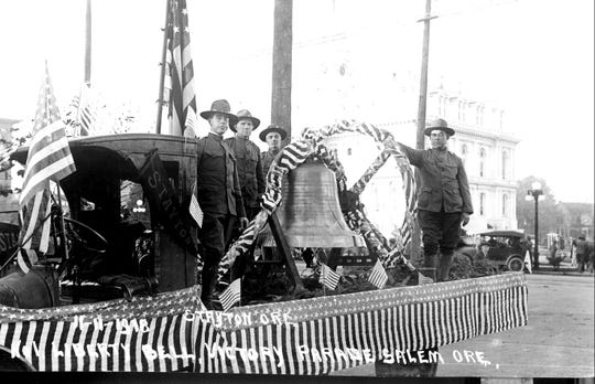 "Stayton and Sublimity residents brought the ""Liberty Bell"" as part of a float in a parade to celebrate the end of World War I. The bell was from a Catholic church in Stayton."