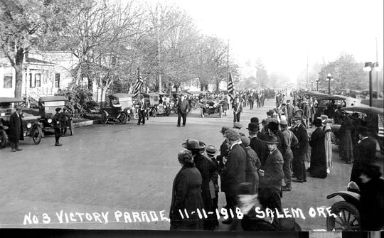 Residents gather on Nov. 11, 1918 to celebrate the end of World War I with a parade.