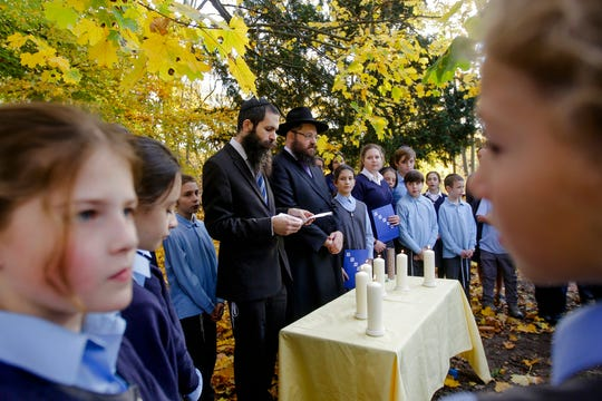 Rabbi Yehuda Teichtal, center right, and Rabbi David Gewirtz, center left, pray during an event to commemorate the victims of the Nov. 9, 1938 terror against the Jews in Germany at the Jewish Traditional School in Berlin, Wednesday, Nov. 7, 2018. During the event, the school also remembered the victims of the anti-Semitic attack at the Tree of Life Synagogue in Pittsburgh, United States, on Oct. 27, 2018.