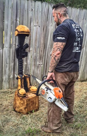 Anthony Marquez, a carving artist and Marine veteran, will be carving a log into a battlefield cross at an Ocean City event to benefit local veterans on Friday, Nov. 9, 2018.
