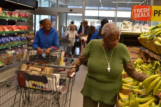 Lola Mills of Salisbury, front, and Dorothy Coles of Princess Anne were among the first customers at the new Aldi store on Route 13 at Dagsboro Road in Salisbury on Thursday, Nov. 8. It is the German grocery chain's first store on the Lower Shore.