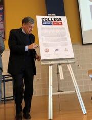 President of Lakeland University David Black signing the proclamation of the collaboration.