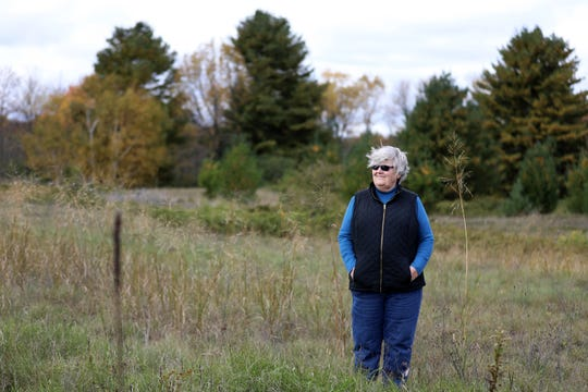 "Mary Faydash, co-founder of Friends of the Black River Forest, has been fighting the proposal to build a golf course on and near Wisconsin's Kohler-Andrae State Park for four years. ""What's motivated me is incredible corruption,"" Faydash says. ""Billionaires feel they can run roughshod over not only our rights, but our health."" She was photographed at Kohler-Andrae on Oct. 11, 2018."