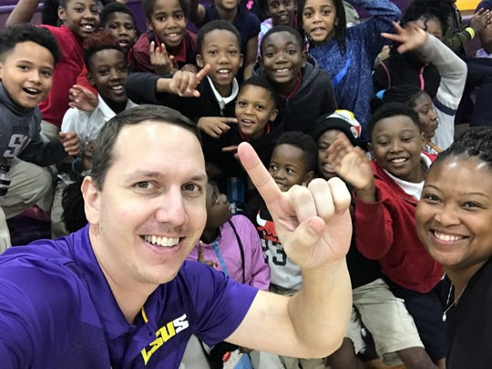 LSUS men's basketball coach Kyle Blankenship has fun with the attendees at Wednesday's Champions of Character game at The Dock.