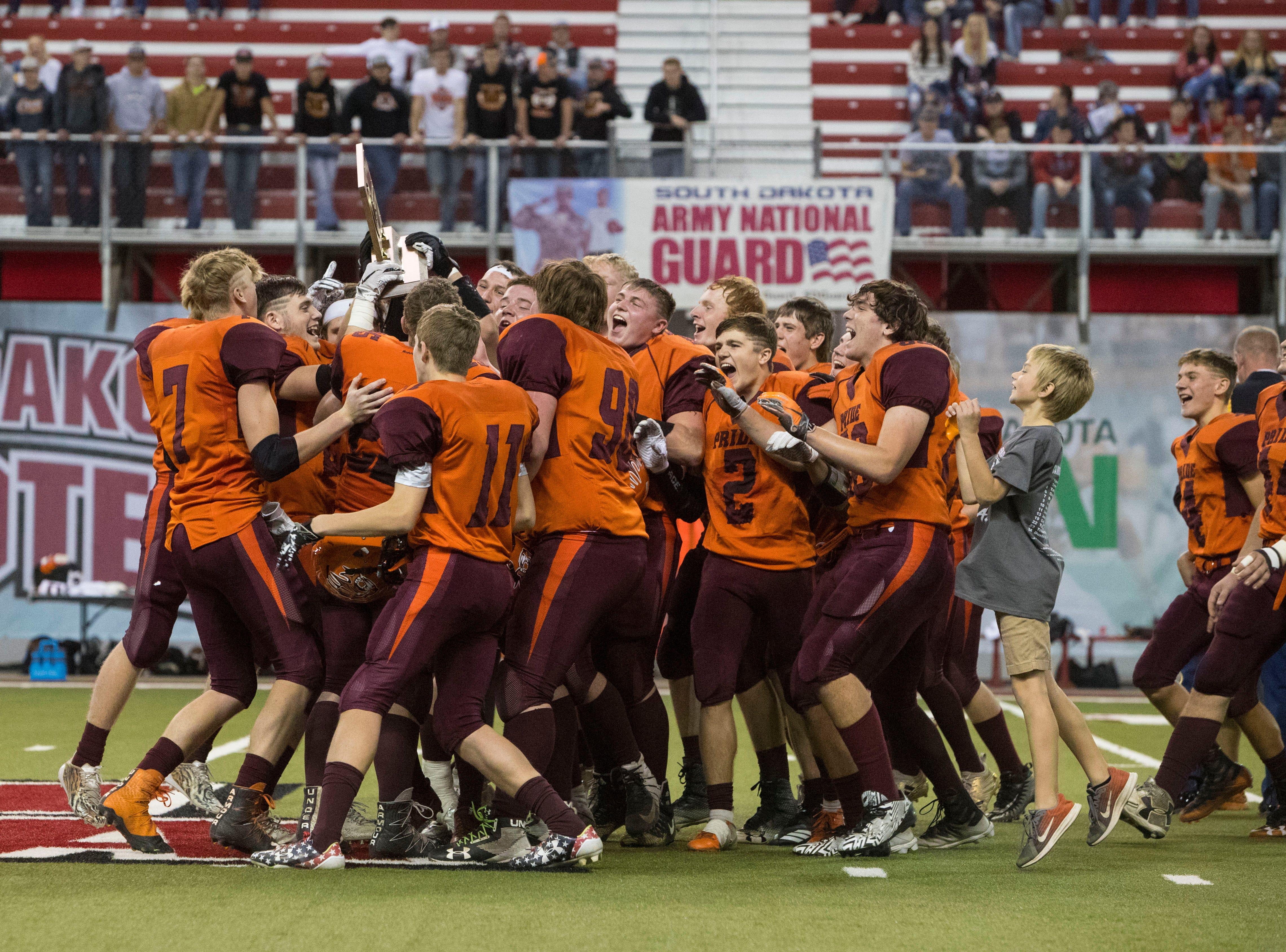 Canistota/Freeman team celebrates after winning the class 9A high school football championship, Thursday, Nov. 8, 2018 at the DakotaDome in Vermillion, S.D.