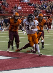 Howard's Zach Party (22) scores a touchdown during a game against Canistota/Freeman, Thursday, Nov. 8, 2018 at the DakotaDome in Vermillion, S.D.