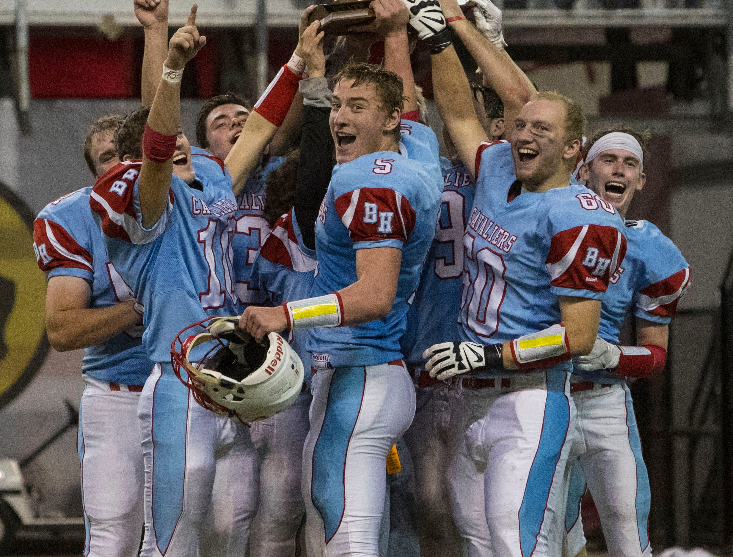 Bon Homme team celebrates after winning the class 9AA high school football championship, Thursday, Nov. 8, 2018 at the DakotaDome in Vermillion, S.D.