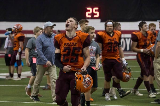 Jason Schwab (25) celebrates after Canistota/Freeman wins the class 9A high school football championship, Thursday, Nov. 8, 2018 at the DakotaDome in Vermillion, S.D.
