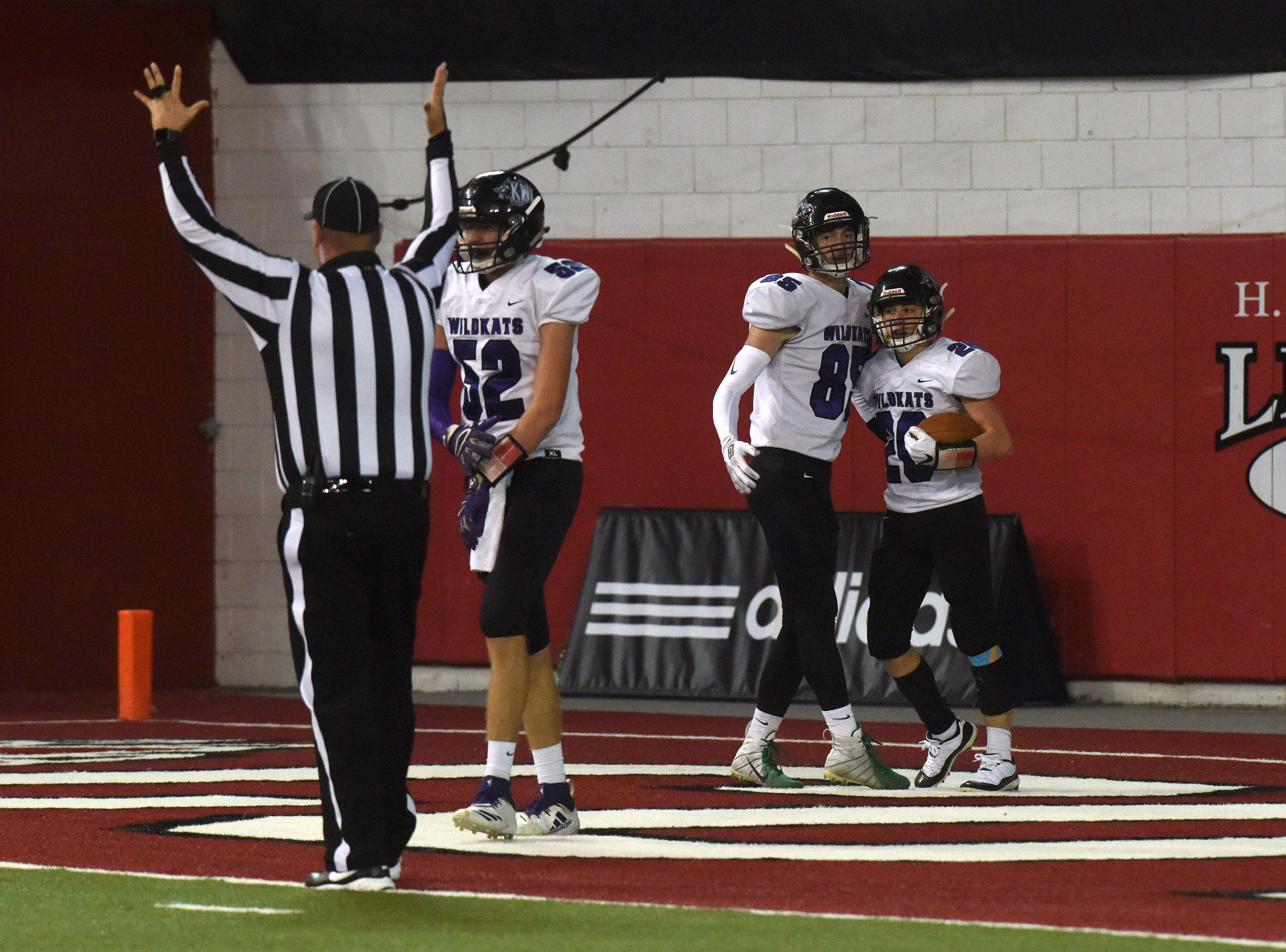 Kimball/White Lake players celebrate after scoring a touchdown during a game against Bon Homme, Thursday, Nov. 8, 2018 at the DakotaDome in Vermillion, S.D.