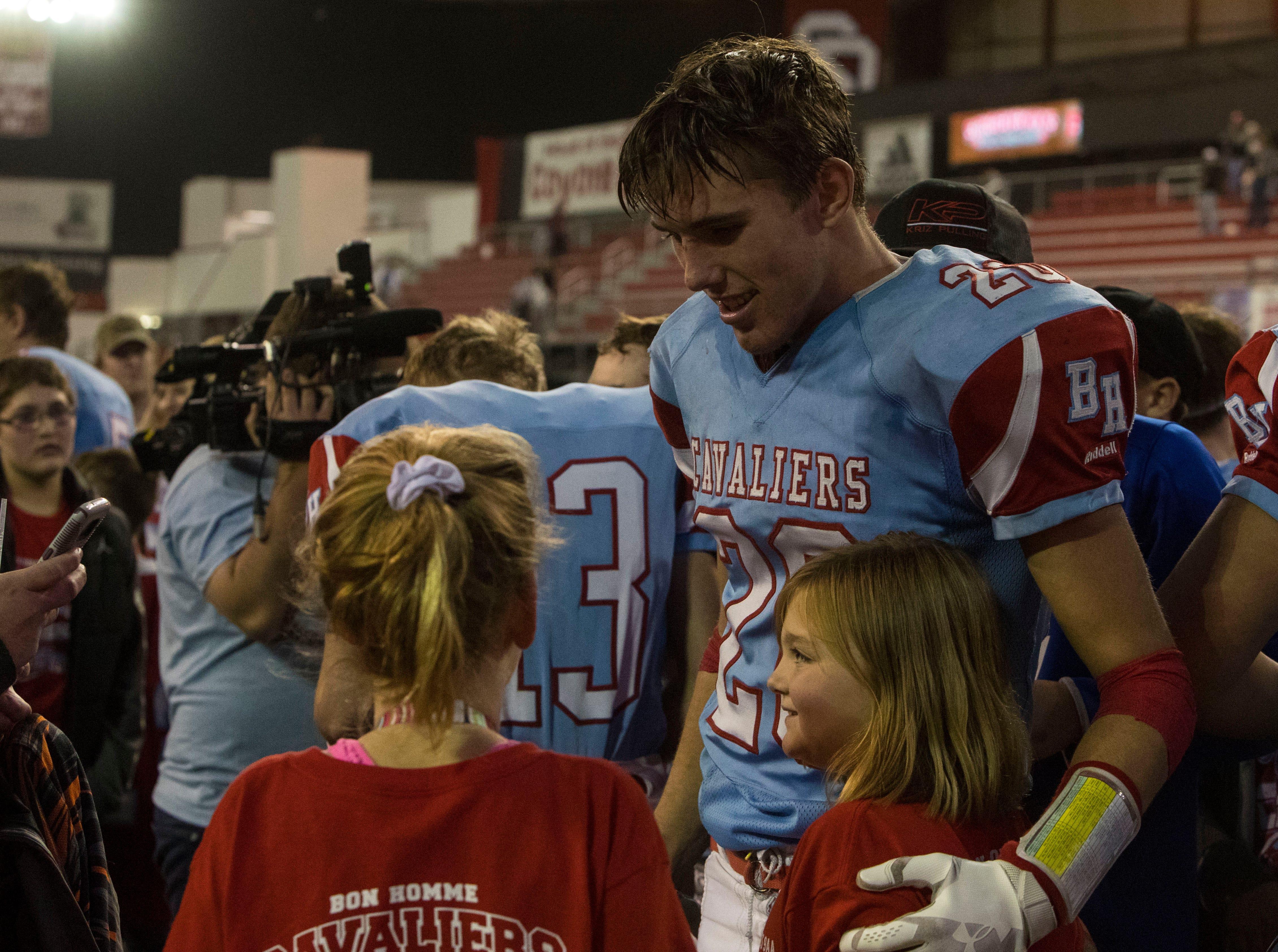 Joshua Crownover (20) celebrates after Bon Homme wins the class 9AA high school football championship, Thursday, Nov. 8, 2018 at the DakotaDome in Vermillion, S.D.