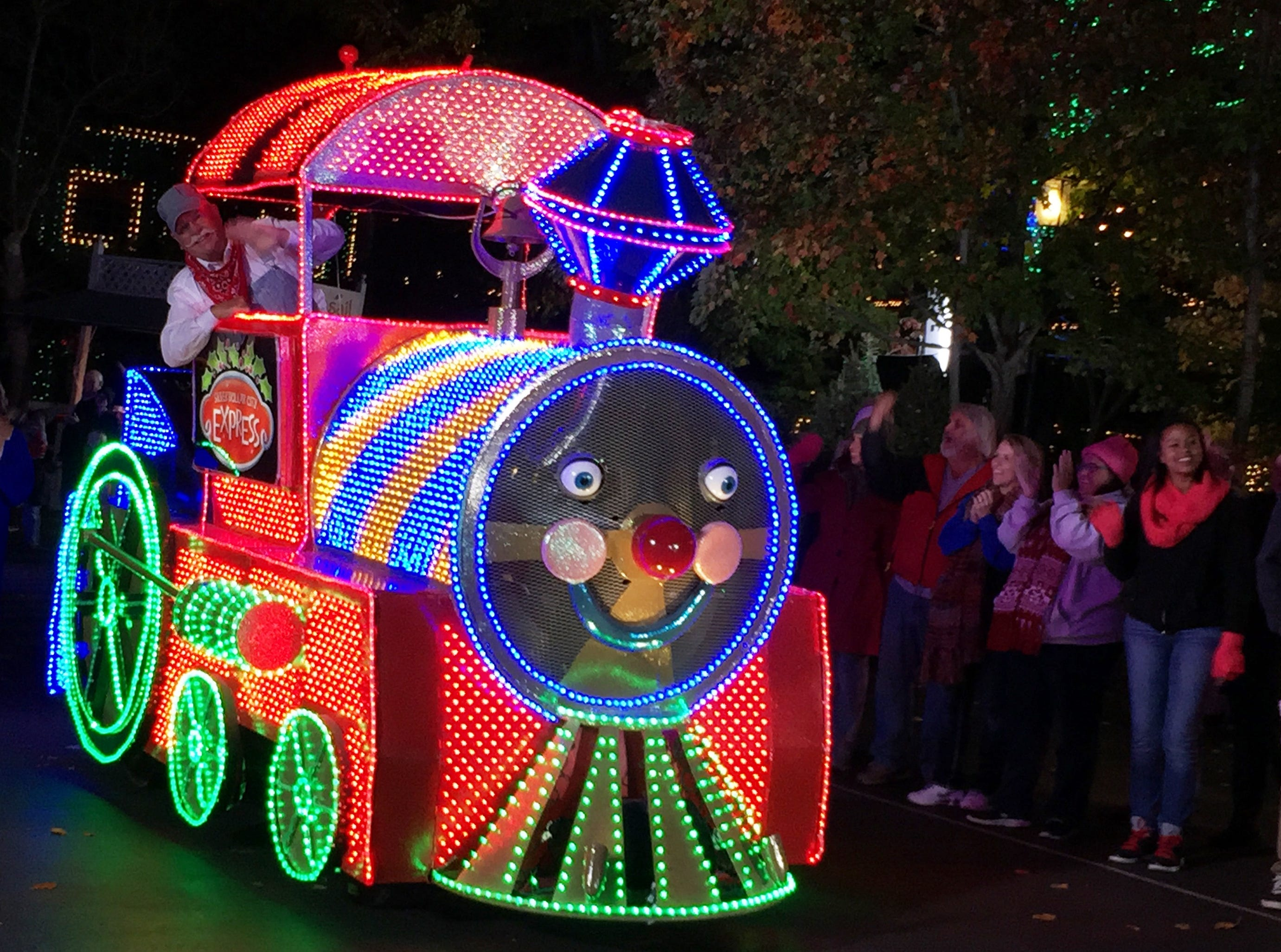 A train engine is part of the Christmas light parade at Silver Dollar City.
