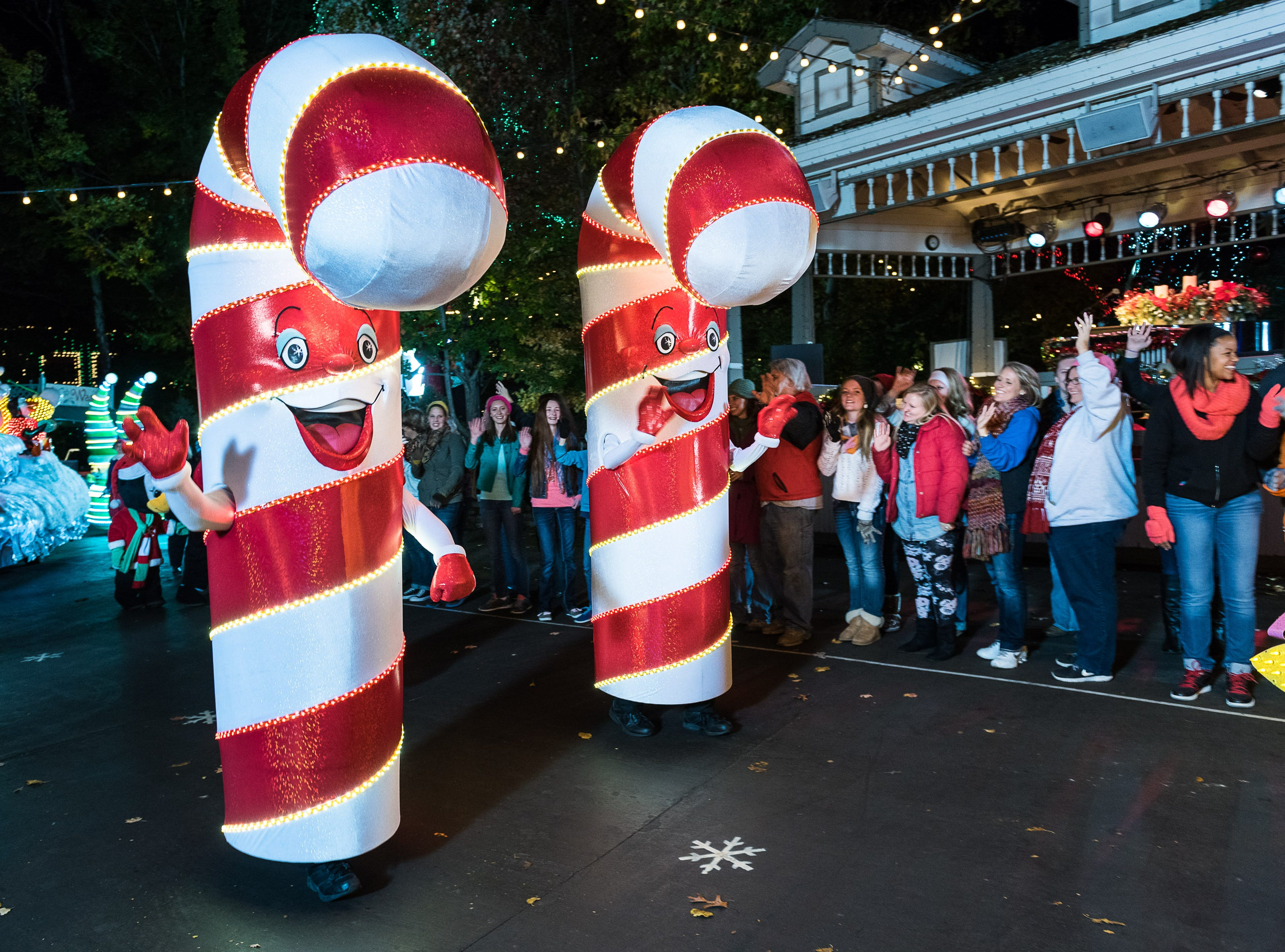 Rudolph's Holly Jolly Christmas Light Parade is accompanied by 45 colorful costumed characters, including these 10-foot candy canes.